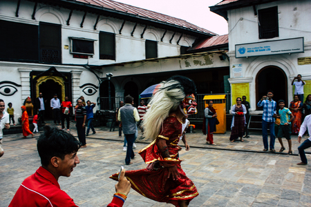 Photo for Kathmandu Nepal August 27, 2018 View of young unknowns people attending a religious ceremony where they must run in front of the Hindu demons at the Pashupatinath temple in the morning - Royalty Free Image