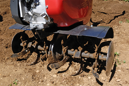 Photo pour detail, Cultivator on a field. - image libre de droit