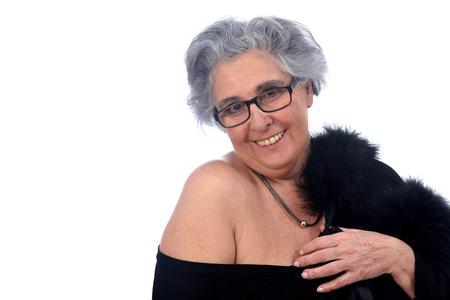 Foto de an older woman with a sexy posed on white background - Imagen libre de derechos