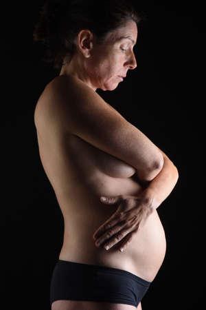 Foto de portrait of a pregnant adult woman - Imagen libre de derechos