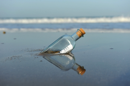 Photo for Message in a bottle on the beach - Royalty Free Image