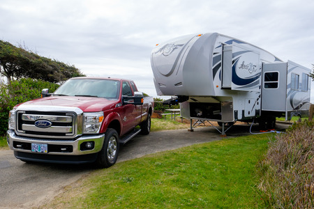 Photo for YACHATS, OR - MARCH 19, 2016: Campsite with a large Arctic Fox 5th Wheel and a Ford F350 truck. - Royalty Free Image