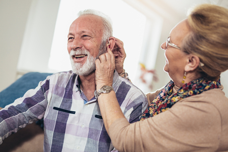 Photo pour Older man and woman or pensioners with a hearing problem - image libre de droit
