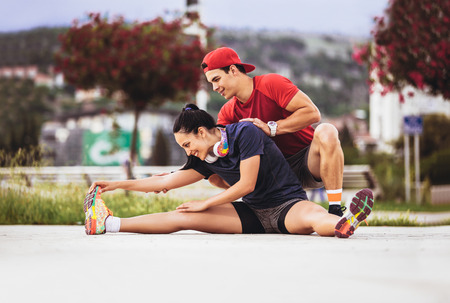 Photo pour fitness, sport, people and lifestyle concept - man and woman exercising outdoors - image libre de droit