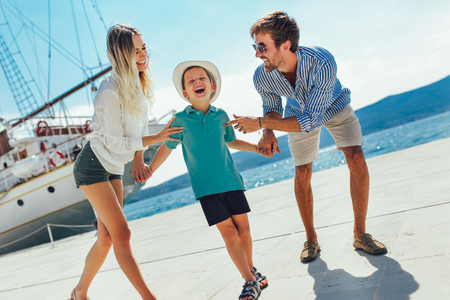 Foto de Happy family having fun, enjoying the summer time by the sea. - Imagen libre de derechos
