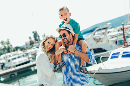 Photo pour Happy family having fun, enjoying the summer time by the sea. - image libre de droit