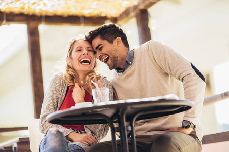 Photo pour Beautiful loving couple sitting in a cafe enjoying in coffee and conversation. Love, romance, dating - image libre de droit