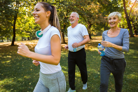Photo pour Senior man and woman and young female instructor  workout on fresh air. Outdoor activities, healthy lifestyle, strong bodies, fit figures. - image libre de droit