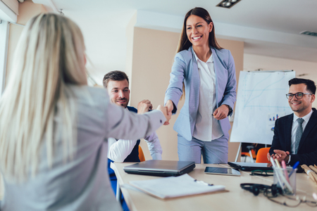 Photo for Businesswomen shaking hands in meeting room. Selective focus. - Royalty Free Image