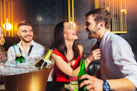 Photo for Happy young people having fun at nightclub. - Royalty Free Image
