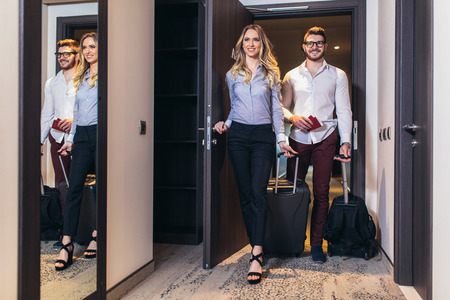 Photo for Vacation for couple. Young couple entering the hotel room together - Royalty Free Image