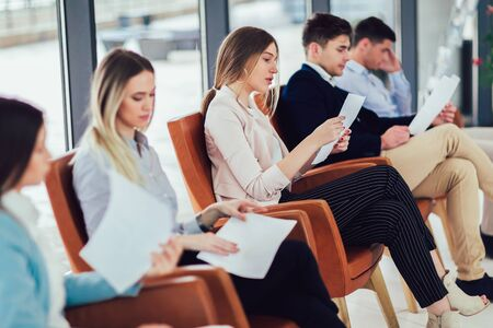 Photo for Photo of candidates waiting for a job interview. - Royalty Free Image