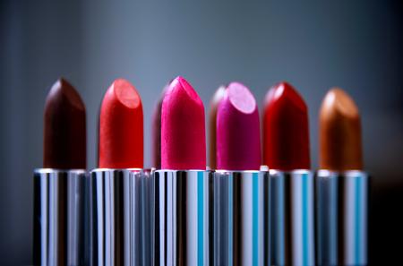 Make-up concept. Lipgloss. Lipsticks closeup Lipstick. Fashion Colorful Lipsticks over black background. Lipstick tints palette, Professional Makeup and Beauty. Beautiful