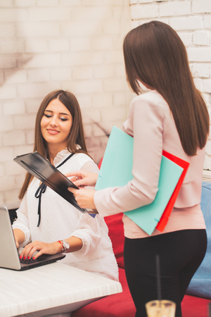 Photo for Woman giving a resume to the interviewer in a job interview - Image - Royalty Free Image