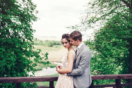 Foto de loving wedding couple embracing the background of the Park in the spring - Imagen libre de derechos