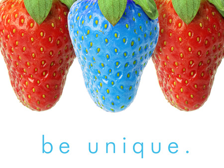 Photo for Blue strawberry between red ones. - Royalty Free Image
