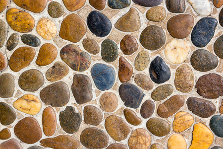 Foto de Wall round stone rock texture and seamless background - Imagen libre de derechos