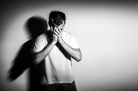 Photo for sad man with hands on face in sadness, on white background, black and white photo, free space - Royalty Free Image