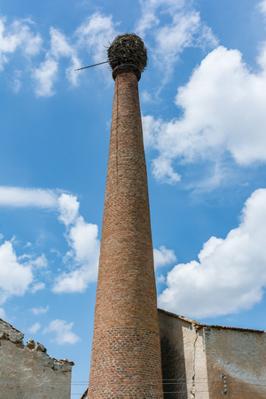 Photo pour Ancient chimney of an abandoned resin factory in Cabezuela in the province of Segovia in Spain. Example of depopulation of the center of Spain - image libre de droit