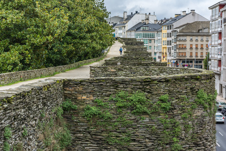 Photo pour The Roman wall of Lugo surrounds the historic center of the Galician city of Lugo in the province of the same name in Spain - image libre de droit