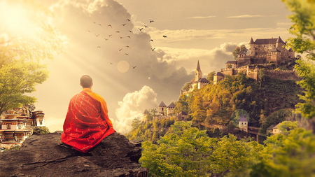 Photo for Buddhist monk who looks at the horizon. fantastic scenery - Royalty Free Image