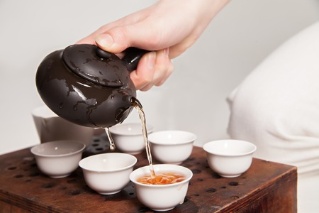 Photo for Chinese tea ceremony is perfomed by tea master in kimono - Royalty Free Image