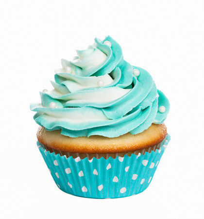 Photo pour Teal birthday cupcake with butter cream icing isolated on white. - image libre de droit