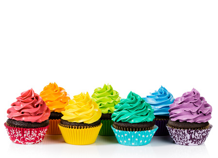 Photo for Chocolate cupcakes in rows with colorful icing on a white background. - Royalty Free Image