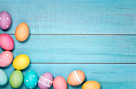 Photo for Colorful Easter Eggs arranged on a blue background. - Royalty Free Image