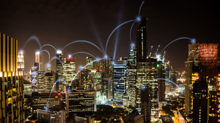 Photo pour Connected city concept: A wireless business network connecting offices in the business skyscrapers of Singapore - image libre de droit