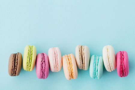 Photo for Cake macaron or macaroon on turquoise background from above, colorful almond cookies, pastel colors, vintage card, top view - Royalty Free Image
