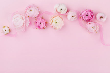 Photo for Beautiful spring flower on pink desk from above for wedding mockup or greeting card on womans day. Floral border in flat lay style. - Royalty Free Image