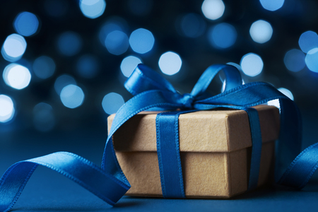 Photo pour Christmas gift box or present against blue bokeh background. Holiday greeting card. - image libre de droit