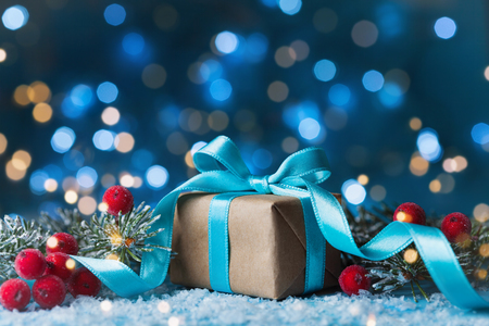 Photo pour Gift or present box, snowy fir tree and christmas decoration on magic blue background. New year greeting card with bokeh effect. - image libre de droit