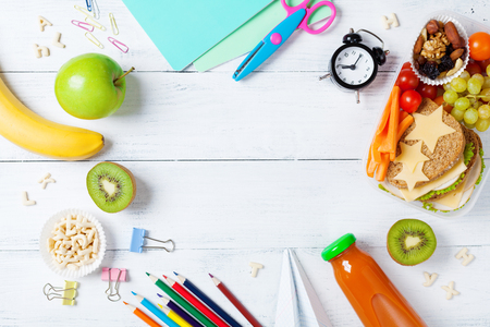 Photo pour Back to school concept. Healthy lunch box and colorful stationery on white wooden table top view. - image libre de droit