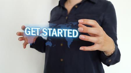 Foto de Business woman using get started text hologram - Imagen libre de derechos