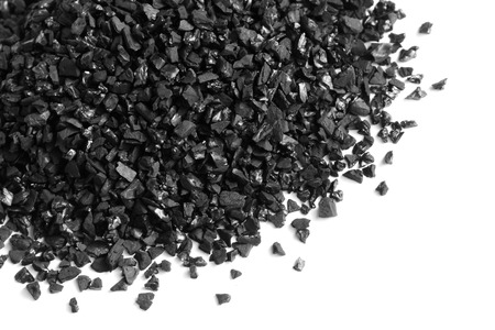 Photo for Granular activated carbon for water filter on white background - Royalty Free Image