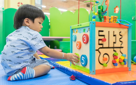 Photo for Asian Baby playing with Educational toy - Royalty Free Image