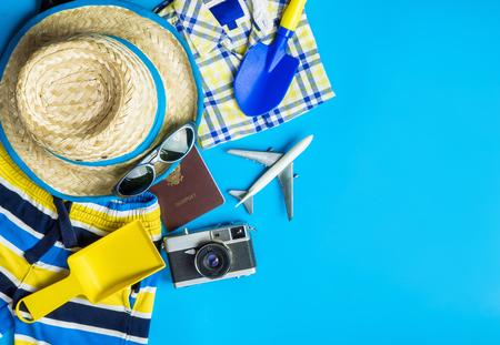 Photo pour Boy travel accessories, fashion  and toys on blue copy space - image libre de droit