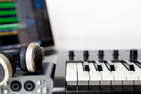 Photo for Computer laptop music studio work station on white background - Royalty Free Image