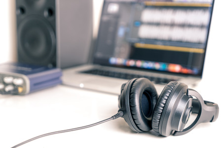 Photo for Black studio headphone in DAW music studio laptop - Royalty Free Image
