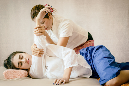 Photo pour Women is getting Thai Massage Spa stretching - image libre de droit