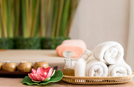 Photo for White towels and Spa objects on Spa Massage bed - Royalty Free Image