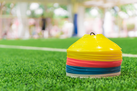 Photo for Plastic cone training plates for Indoor grass field sport training - Royalty Free Image