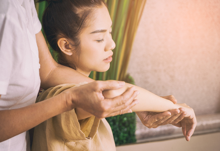 Photo for Thai Masseur is giving a massage on a woman arm - Royalty Free Image