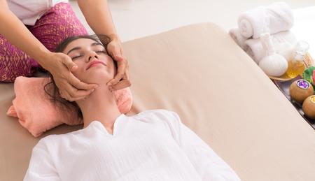 Photo pour Woman is getting face massage in a face spa course - image libre de droit