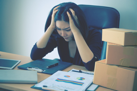Photo for Start up business woman is stressing out on sale report for her start up business - Royalty Free Image