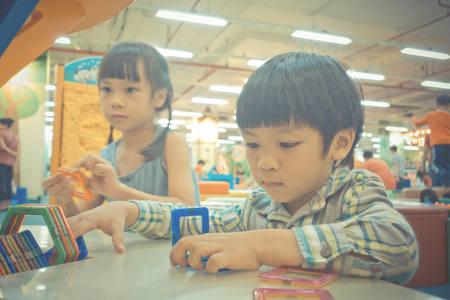 Foto de Two Asian Baby playing with Educational toy - Imagen libre de derechos
