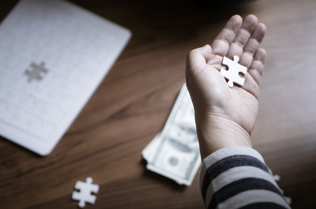 Photo for Hand placing last jigsaw for business financial solution - Royalty Free Image