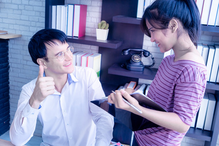 Photo for Boss thumb up for female worker compliment - Royalty Free Image